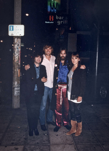 Legendary L.A. DJ Rodney Bingenheimer, Sid Griffin, Sky Saxon and Laura Benson on the Sunset Strip, 1986.