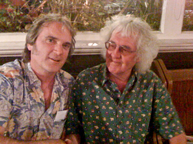 Our hero shakes hands with UK blues & bluegrass great Wizz Jones in Battersea, June 2010, after a great session at Guitar Classics shop.