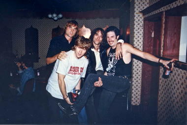 Our hero, Warner Bros.' PR genius Rick Gershon, REM's Peter Buck and Long Ryder Greg Sowders look silly at Raji's in Hollywood, 1987.