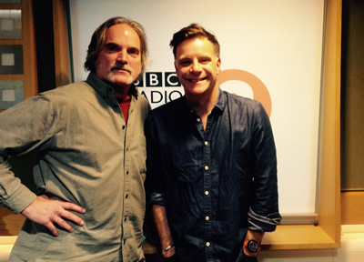 Looking big of body & small of head, Sid poses with a properly proportioned Deacon Blue's Ricky Ross at BBC Radio 2 in London, Nov. 17, 2014.